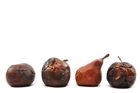 putrid: Rotten apples and pear isolated on white background.