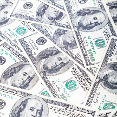 one hundred dollar bill: A stack of hundred-dollar bills as a background. Stock Photo