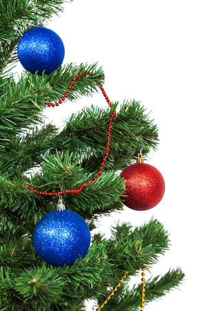 christmas decorations with white background: Christmas tree decorated with blue and red balls.