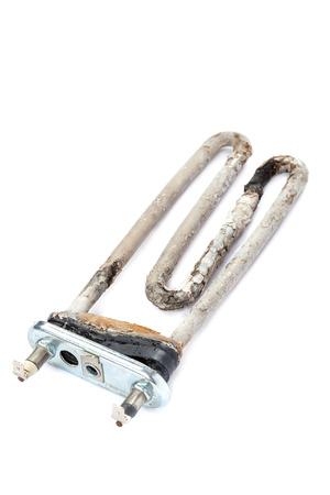 calcification: Damaged heating element of the washing machine isolated on white background. Stock Photo