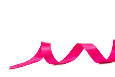 Holiday pink ribbon isolated on white background.
