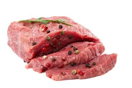 Raw meat and spices isolated on white background.