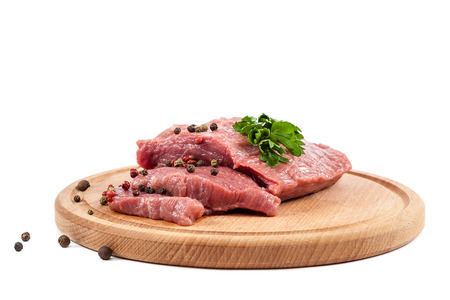 animal blood: Meat on a cutting board isolated on white background.
