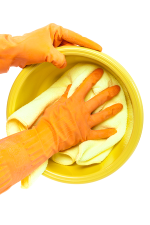 dish washing gloves: Hands in rubber gloves washing the plastic dish towel isolated on white background.