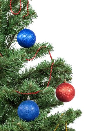 Christmas tree with red and blue baubles isolated on white background. 版權商用圖片