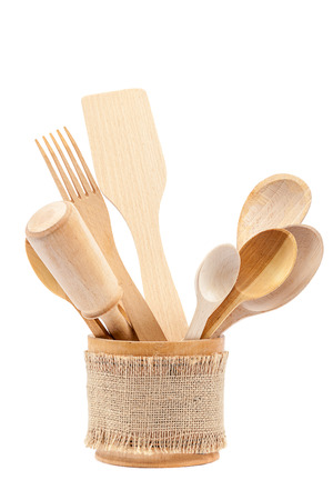 cooking implement: Set of wooden kitchen utensils isolated on white background.