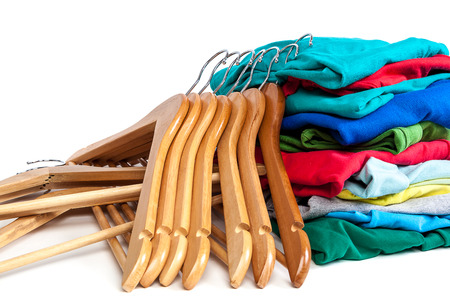 closet rod: Hangers with clothes isolated on a white background.