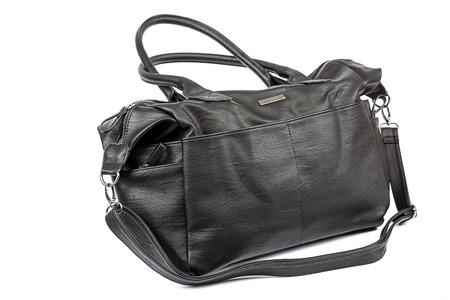 woman handle success: Stylish black leather female bag isolated on white background.