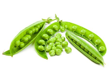 peas in a pod: Green peas in the pod isolated on white background. Stock Photo