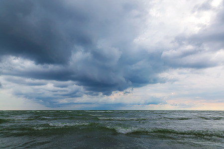 wavely: Sea and sky in a storm. Seascape. Stock Photo