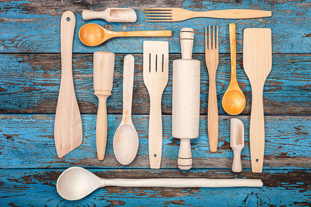 cooking implement: Set kitchen utensils on a wooden background. Accessories for cooking. Stock Photo