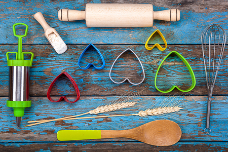 pastry cutters: Accessories for baking. Cookie cutters, pastry syringe, whisk on a wooden background.