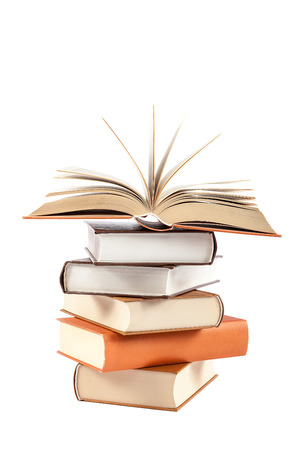 A stack of books on a white background. Stock Photo