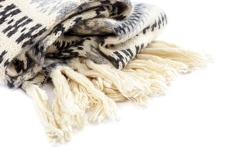 Scarf knitted motley isolated on a white background. Stock Photo
