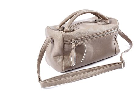 Female handbag isolated on a white background.