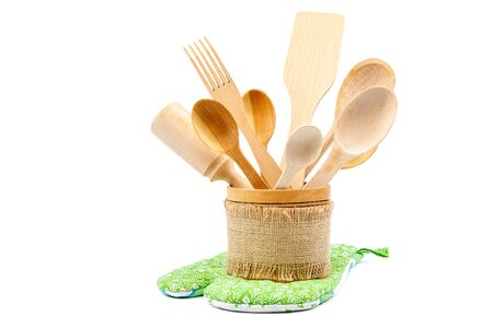 kitchen appliances: Set of wooden kitchen utensils isolated on white background.