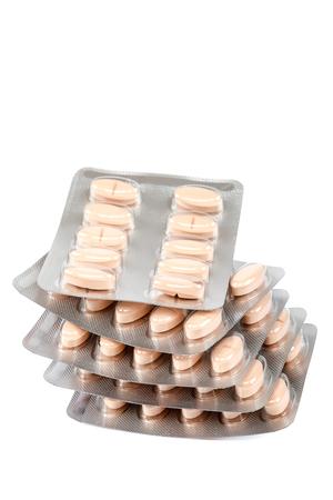 pilule: Píldoras en paquetes de ampolla aislados sobre fondo blanco. Foto de archivo