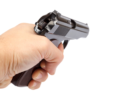 Gun in hand isolated on white background.