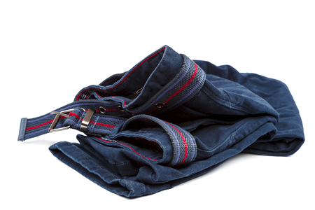 Denim trousers with a brown belt isolated on white background. Stock Photo