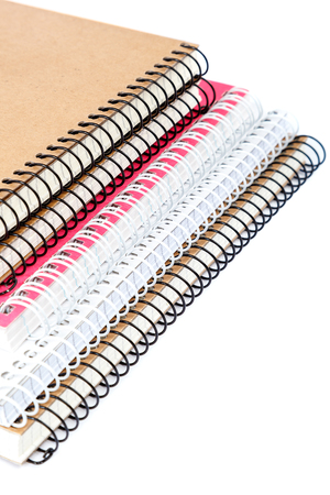 Stack spring notebooks isolated on white background. Imagens