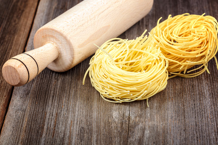 Pasta vermicelli on a wooden background.