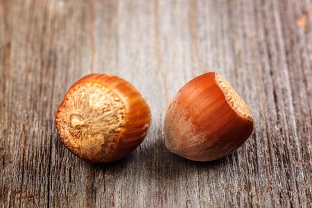 Hazelnut on a wooden background. Healthy food.