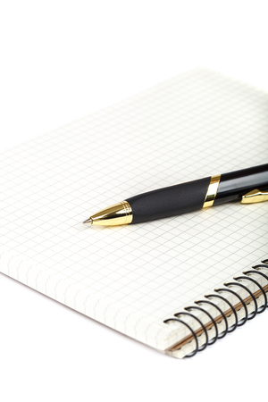 Automatic ballpoint pen and notepad isolated on white background.
