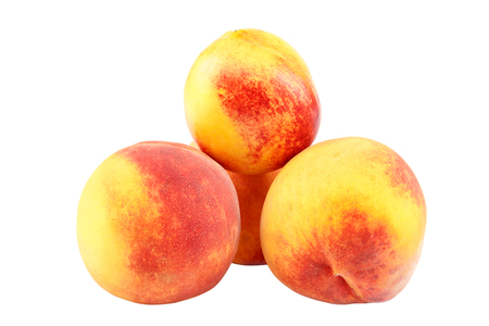 Fresh peach fruits isolated on white background.