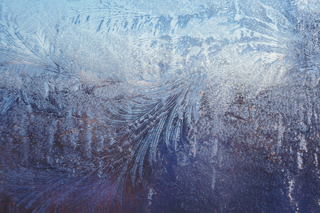 Ice frosty patterns on the winter window glass. Stock Photo