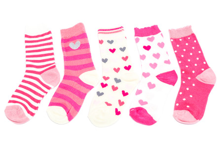 Baby pink socks isolated on white background. Stock Photo