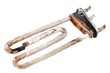Damaged heating element of the washing machine is isolated on a white background. 免版税图像