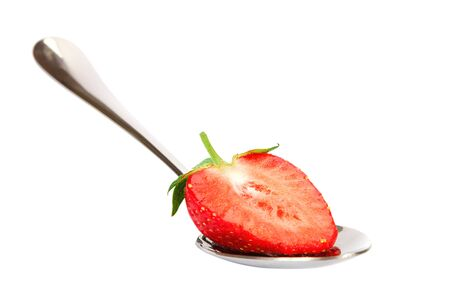 Fresh strawberries isolated on a white background.