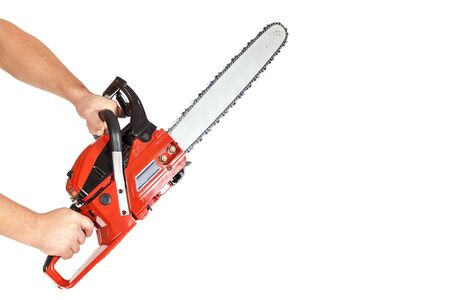 Chainsaw in a male hand isolated on a white background.