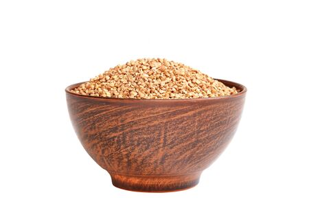 Buckwheat groats in a bowl isolated on a white background.