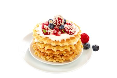 Fresh blueberries, raspberries and waffle cookies isolated on a white background. Banque d'images