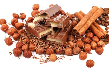 Chocolate tiles and nuts isolated on white background.