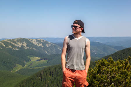 Young man traveling on a mountain top.