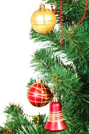 Decorated artificial Christmas tree isolated on white background. 版權商用圖片