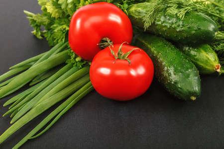 Fresh vegetables assorted on a black background. Standard-Bild