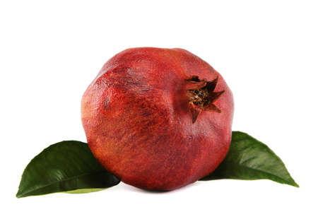 Pomegranate with green leaves isolated on white background.