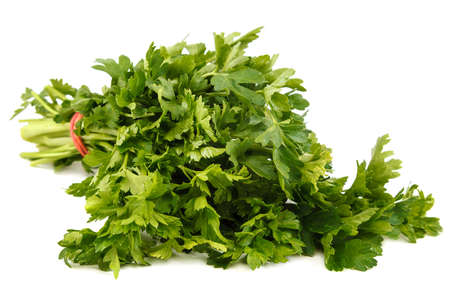 Bunch of fresh parsley isolated on white background.
