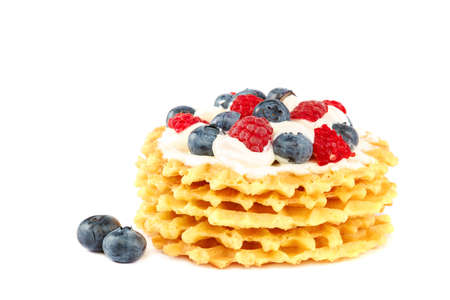 Fresh blueberries, raspberries and waffle cookies isolated on a white background. Standard-Bild