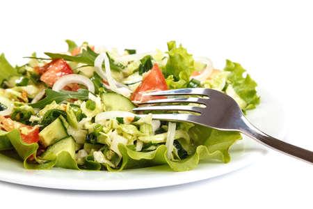 Fresh vegetable salad isolated on a white background. Standard-Bild