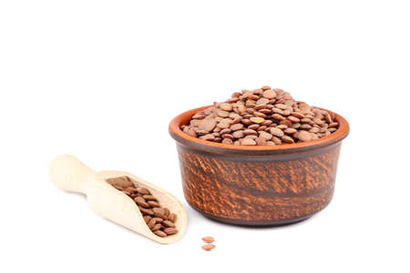 Grains of lentils in a bowl isolated on a white background. Standard-Bild