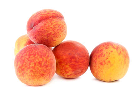 Fresh peach fruit isolated on a white background.