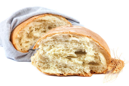 Loaf of rye bread isolated on white background.