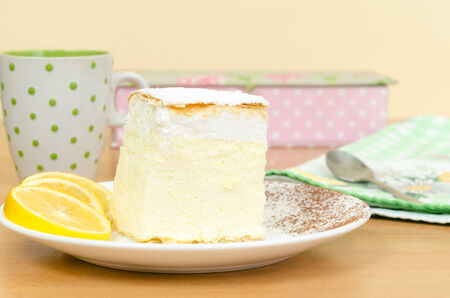 slice of cake: Fresh yellow vanilla slice cake with lemon on a plate