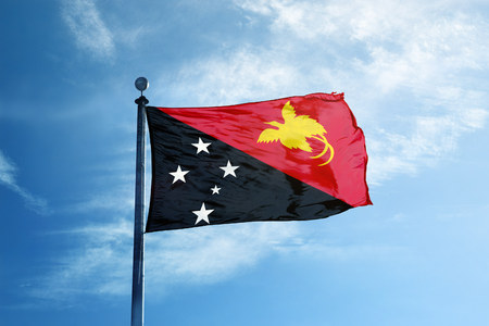 Papua New Guinea flag  on the mast Stock Photo - 104288784