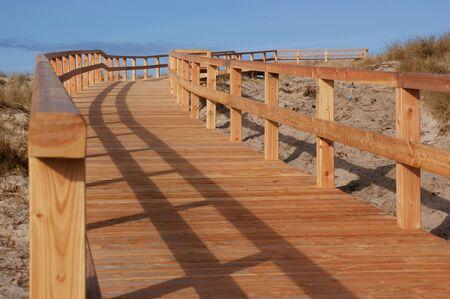deflection: Hlzerner way through the dunes Stock Photo