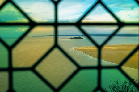 st michel: A view through a window at the famous Mont St Michel abbey in France. Stock Photo